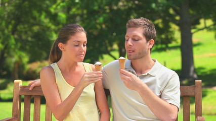 Lovers enjoying ice creams