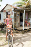 Nicaragua mother daughter bicycle poverty house Corn Island poster