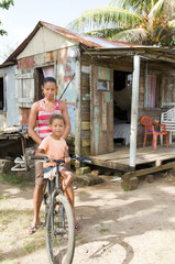 Nicaragua mother daughter bicycle poverty house Corn Island