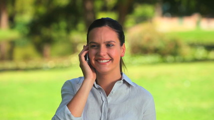 Good looking woman speaking on the phone