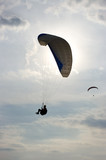 Paraglider silhouette and beautiful sky