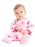 Cute isolated baby girl in pink sitting