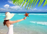 beach hat woman starfish in hand tropical Caribbean