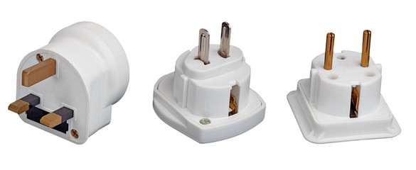 Three different electrical adapters isolated on a white backgrou