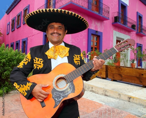 Charro Mariachi playing guitar Mexico houses