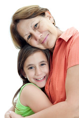 Latin girl hugging her grandmother isolated on a white backgroun