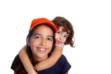 Beautiful Latin teen hispanic girl with little friend smiling