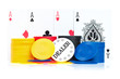Four aces, poker chips and dealer button on a white background