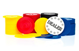 Poker chips and dealer button on a white background