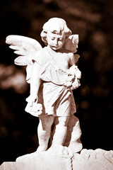 Statue of an infant angel in sepia shades