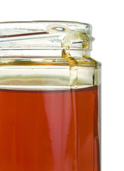 Glass honey jar isolated on a white background