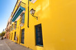 Street in Old Havana with a colorful yellow wall