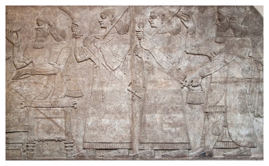 Ancient relief of assyrian winged gods and archers