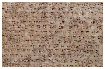 Ancient assyrian clay tablet with cuneiform writing