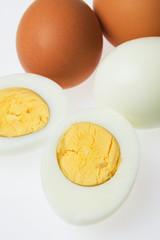 Hard boiled eggs on white background