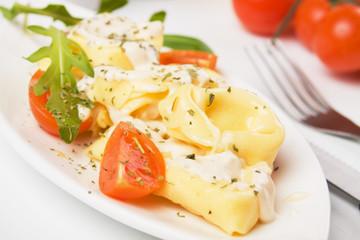 Italian tortellini pasta in cheese sauce