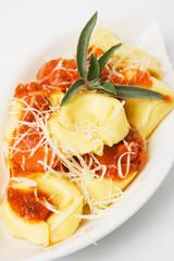 Tortellini pasta in basilico sauce