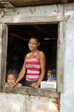 Nicaragua mother daughter  smiling poverty house Corn Island poster