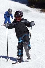 young boy skiing