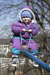 little girl on the seesaw - smile