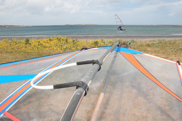 sail of board ready to windsurf