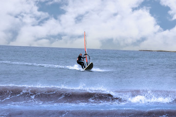 surfer windsurfing in a storm