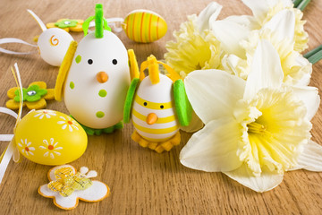 Easter chicken egg decoration with narcissus flower
