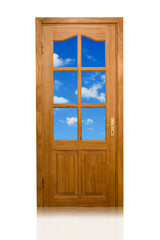 wooden door to the blue sky with white clouds