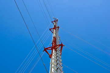 Transmitter tower with sling on blue sky, Thailand.