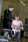 Woman Exercising With Physical Trainer