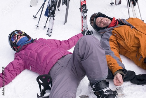 Two Skiers Resting In The Snow, Whistler, Bc, Canada