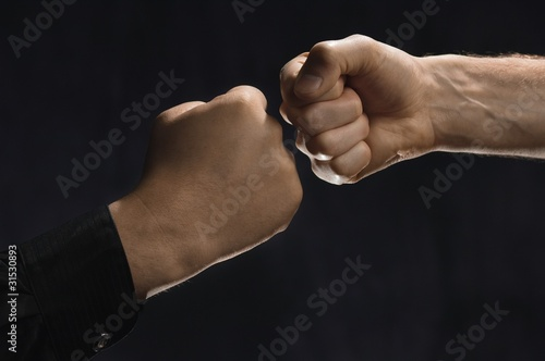Two Men Knocking Fists Together