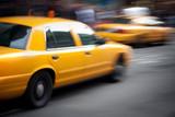 Fototapety Speeding Yellow Taxi Cabs Motion Blur