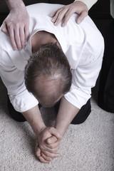 Man Praying On His Knees