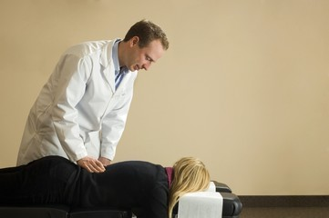 Chiropractor With His Patient