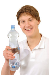Young man with bottle of pure water