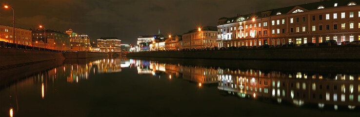 Moscow, night view (panorama) on the drain channel with bridge