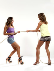 two girls pull the rope
