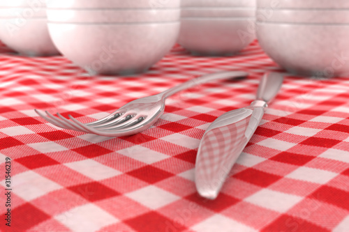 Fork and Knife closeup on a red table cloth