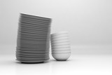 Stacked dishware on white background