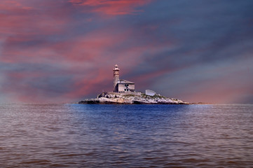 lighthouse in the dusk at sunset