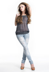 Beautiful  young sexy woman in jeans in studio