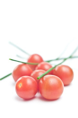 Cherry tomatoes with chive on white