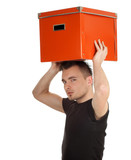 serious young man in black shirt with big orange box