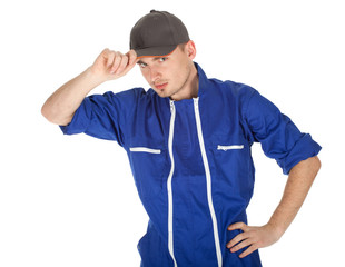 standing young man in coveralls and baseball cap, series