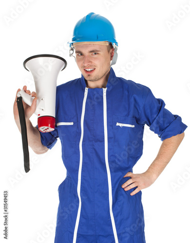 young man in blue helmet and overalls with megaphone