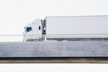 Semi-truck driving on overpass