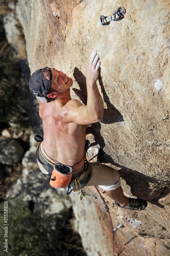 Rock climber reaching top of route