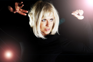blond woman dancing in the dark