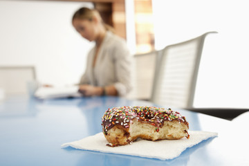 Close up of donut on conference room table